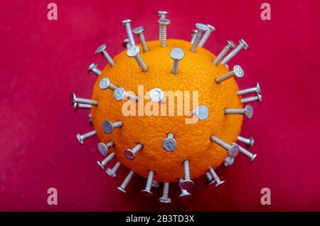 Conceptual image of virus. An orange studded with nails. Imitation of virus close-up. Chinese epidemic. Health hazard. - Stock Photo