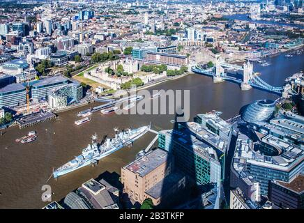 The view over London with the shadow of the Shard in the foreground. - Stock Photo