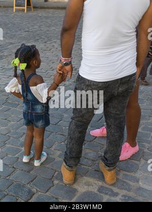 Family standing on the street, Havana, Cuba