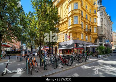 Bicycles on narrow street and typical historic buildings in old city of Vienna - capital and largest city of Austria. - Stock Photo