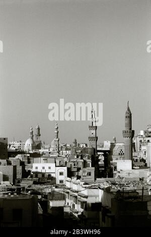 Black And White Travel Photography - Cityscape over the downtown Islamic Fatimid districts of the city of Cairo in Egypt in North Africa Middle East - Stock Photo
