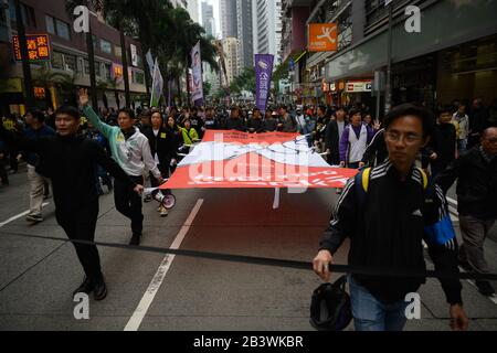 Hong Kong - Jan 1, 2020: A million attend demo, demand for universal suffrage, 2020 direct democratic elections for Legislative Council without functi