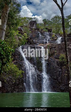 Cedar Creek Falls in North Queensland with the water flowing again after summer rain - Stock Photo