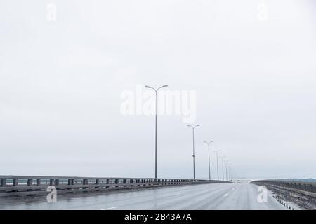 industrial and transport concept of empty free European highway between mountains scenery landscape in cloudy and rainy weather.rainy road without