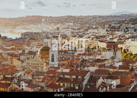 scenery panoramic aerial city scape view of Nice, France. red roofs, big ferris wheel, harbor, houses, church and architecture in Nice. Cote d'Azur Fr - Stock Photo
