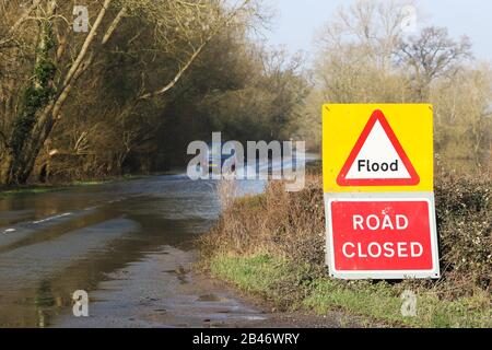 Lower Apperley, Gloucestershire, UK. 6 March 2020. First day of sun for almost two months of rain and people ignore road closed signs to drive through dangerous flooded roads in and around Lower Apperley, Gloucestershire in England, UK. Credit: Thousand Word Media Ltd/Alamy Live News - Stock Photo