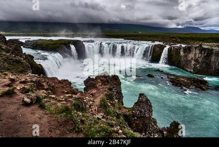 The Goðafoss is one of the most spectacular waterfalls in Iceland. It is located in the Bárðardalur district of North-Central Iceland at the beginning of the Sprengisandur highland road. The water of the river Skjálfandafljót falls from a height of 12 meters over a width of 30 meters. - Stock Photo