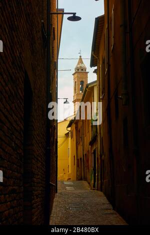 Perspective of old narrow street in Rimini, Italy