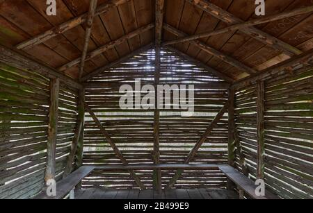 Hut made of thin wooden sticks to protect hikers, view through the interior - Stock Photo
