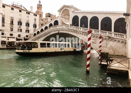 Venice, February 25th - March 3rd. 2020: Ponte Rialto, one of the most popular tourist attractions on the island without its normal hoard of tourists because they have cancelled their visit to Venics due to the Coronavirus epidemic. - Stock Photo