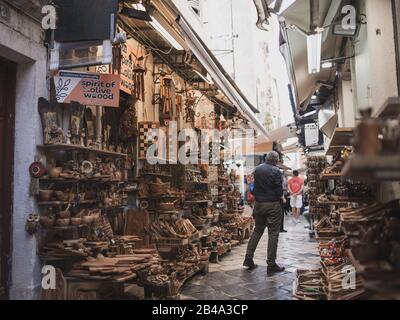 Kerkyra, Corfu Island, Greece - October 4, 2019: Town on Corfu Island in Ionian sea. Greece. Wooden souvenirs in shops in small street, touristic town - Stock Photo