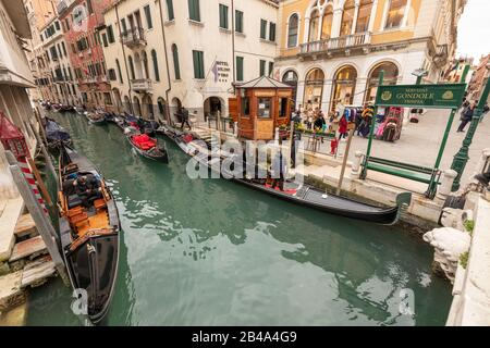 Venice, February 25th - March 3rd. 2020: Gondalas moored along a canal  as Coronavirus epidemic has had the effect of detering tourists from visiting the island and has resulted in Gondoliers losing custom. - Stock Photo
