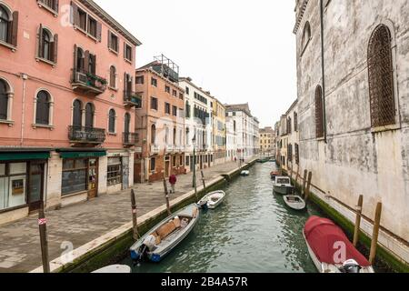 Venice, February 25th - March 3rd. 2020: Coronavirus epidemic has had the effect of detering tourists from visiting the island and has resulted in Gondoliers losing custom. - Stock Photo