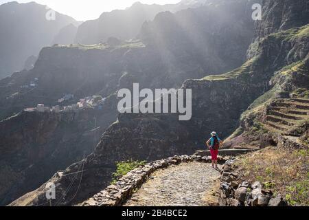 Cape Verde, Santo Antao island, hike on the coastal path from Ponta do Sol to Cruzinha da Garça, Fontainhas village in the background - Stock Photo