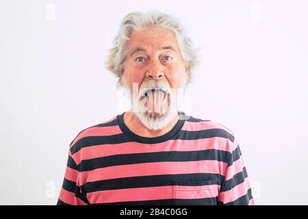 Nice and rare people old mature expression in portrait - fun with on limit age concept - mature male show his tongue with crazy hair and face - cute handsome male funny retired lifestyle