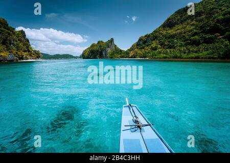 Boat trip to tropical islands El Nido, Palawan, Philippines. Steep green mountains and blue water lagoon. Discover exploring unique nature, journey to paradise. - Stock Photo