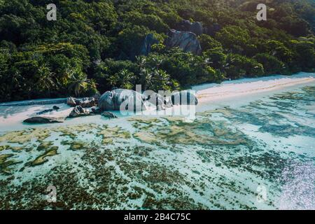 Aerial view of bay with shallow water on early morning of unique Anse Source D'Argent tropical beach, La Digue Seychelles. Luxury exotic travel concept. - Stock Photo