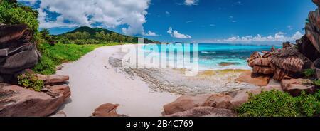 Panoramic view of most spectacular tropical beach Grande Anse on La Digue Island, Seychelles. Vacation holidays relaxing concept. - Stock Photo
