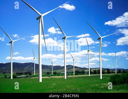 Wind turbine farm power generator in beautiful nature landscape for production of renewable green energy is friendly industry to environment. Concept
