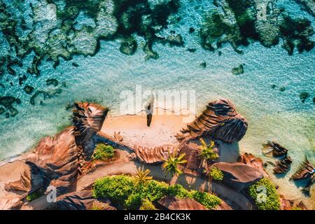 Anse Source D argent beautiful famous beach at La Digue Island, Seychelles. Aerial drone top down photo from above perspective.