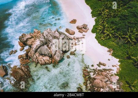 Aerial view of Anse Cocos beach at La Digue, Seychelles. Exotic tropical travel concept.