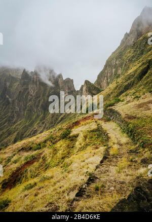 Santo Antao, Cape Verde. Mountain ridge with foggy clouds above on hike rout 303 to Xoxo in the Ribeira da Torre valley. - Stock Photo