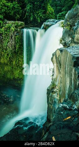 Close up of Tegenungan Waterfall near Ubud in Bali, Indonesia. - Stock Photo