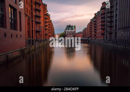 Hamburg, Warehouse District Speicherstadt, Germany, Europe, View of Wandrahmsfleet on evening light, famous sightsee located in the port of Hamburg,