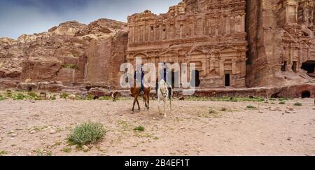 Two Mounted Police Patrol Petra, Jordan - Stock Photo