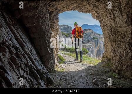 Misurina, Auronzo di Cadore, Belluno province, Veneto, Italy. A climber on the way on the via ferrata 'Bonacossa' in the cadini group - Stock Photo