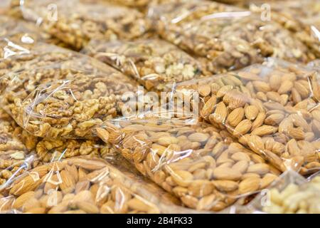 Packaging from a transparent bag with almonds and walnuts. Close up.