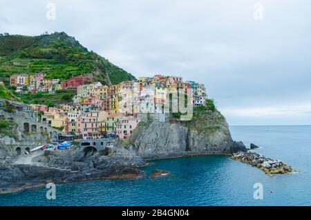 Amazing view of Manarola in Cinque Terre before sunset in Italy - Stock Photo