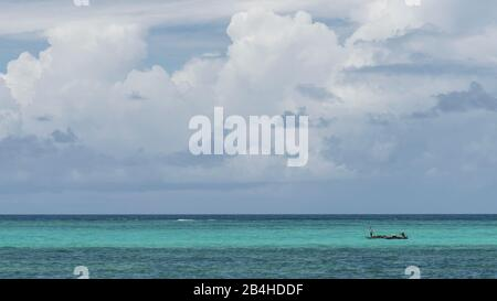 Zanzibar, Tanzania: dream beach on the east coast of this African island in the Indian Ocean. Fishing boat on the turquoise blue sea.