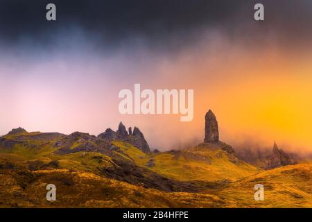 Old man storr in isle of skye with magic orange light abstract feel - Stock Photo