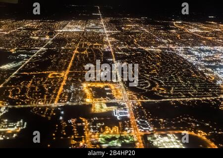 Flying over the suburbs of Toronto at night on a flight to Newfoundland, Canada - Stock Photo