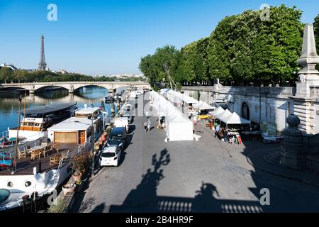 View from the Pont Alexandre III bridge to the market stalls standing on the banks of the Seine, Paris, France, Europe - Stock Photo