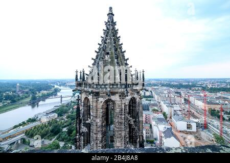 Germany, Saxony-Anhalt, Magdeburg, view of the north tower of the Magdeburg cathedral, on the left the lifting bridge and the city park, on the right building trowels and excavations. - Stock Photo