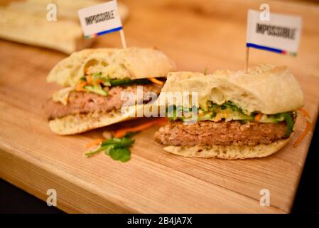 Cooked vegan, plant-based protein (fake meat) 'pork' appetizers made with Impossible Pork sampled by attendees at CES, Las Vegas, NV, USA - Stock Photo