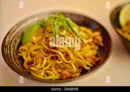Vegan, plant-based protein (fake meat) 'pork' in Chinese Dan Dan noodles made with Impossible Pork sampled by attendees at CES, Las Vegas, NV, USA - Stock Photo
