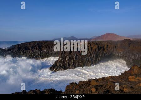 Surf on rocky coast, Los Hervideros, at Yaiza, Lanzarote, Canary Islands, Spain - Stock Photo