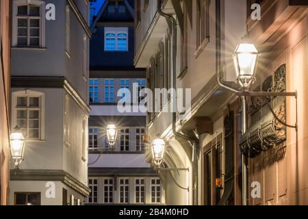 Frankfurt am Main, Hesse, Germany, half-timbered facades in the alley Hühnermarkt in the new old town at dusk. - Stock Photo