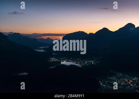 Switzerland, Graubünden, Engadin, Muottas Muragl, dusk over the Upper Engadine lakes with St. Moritz and Celerina - Stock Photo