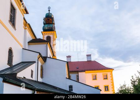 Colourful yellow bell tower on an old church or building in Passau Bavaria viewed under a cloudy sky in an urban environment maria hilf