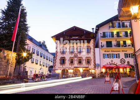 Town Square in St. Wolfgang, Salzkammergut, Austria with colorful buildings illuminated at night - Stock Photo