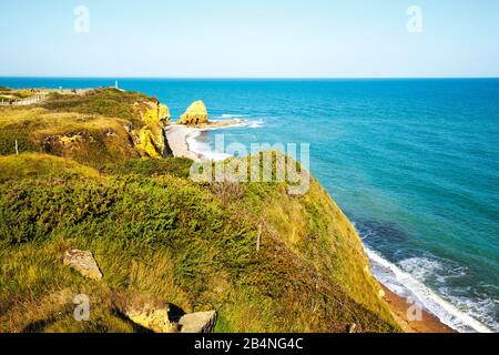 The Pointe du Hoc is a section of the steep coast on the Calvados coast in Normandy. Strategic point in WWII during the invasion. - Stock Photo