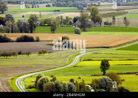 The Mont Dol is a 65 meter high granite chunk in a flat Breton landscape, on the plateau of which there are various buildings. View from the lookout tower on Mont Dol to the typical Breton landscape.