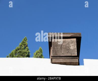Beehive on top of the roof of a residential property image with copy space in horizontal format