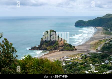 The distinctive volcanic Lion Rock at Piha, near Auckland on the west coast of North Island, New Zealand - Stock Photo