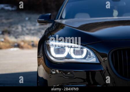 M body kit bumpers, M alloy wheels, series 750d, a lot of horse power and matte black ornaments isolated, no people Stock Photo