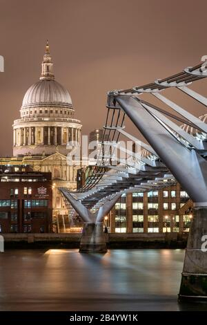 London, UK - Jan 2020: St Paul's Cathedral along the length of Millennium Bridge